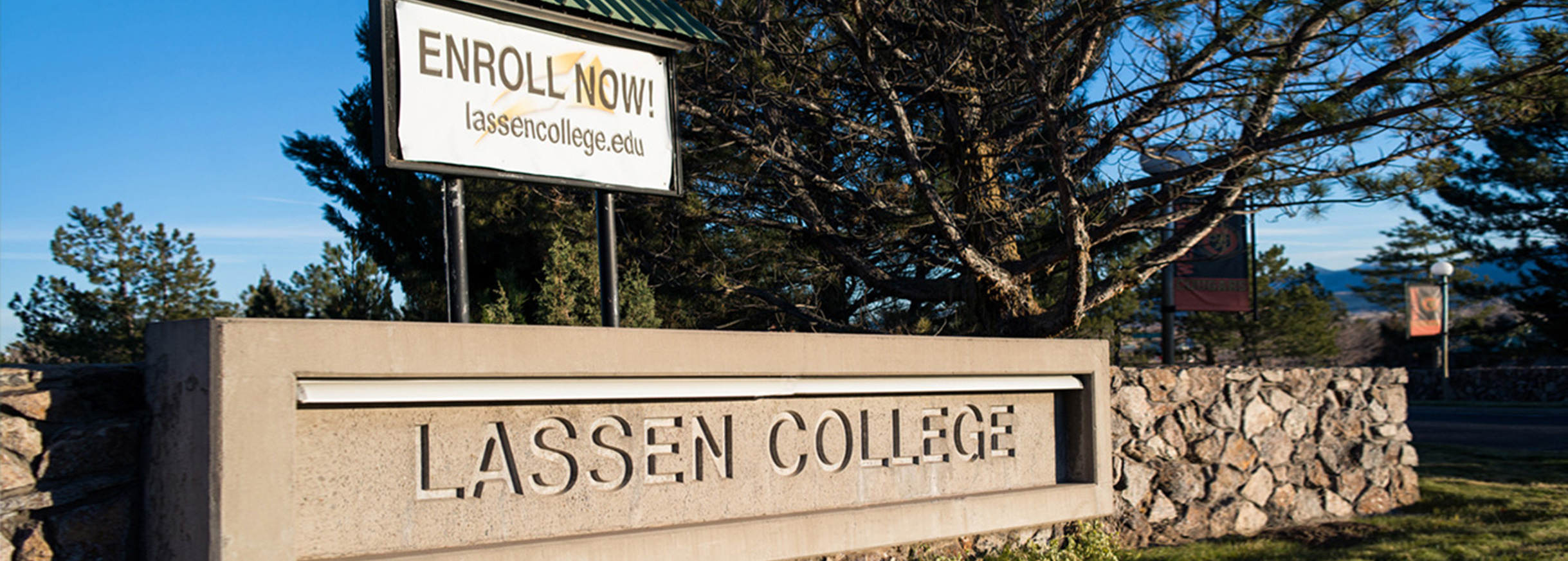 Lassen College campus entrance sign with Enroll Now billboard